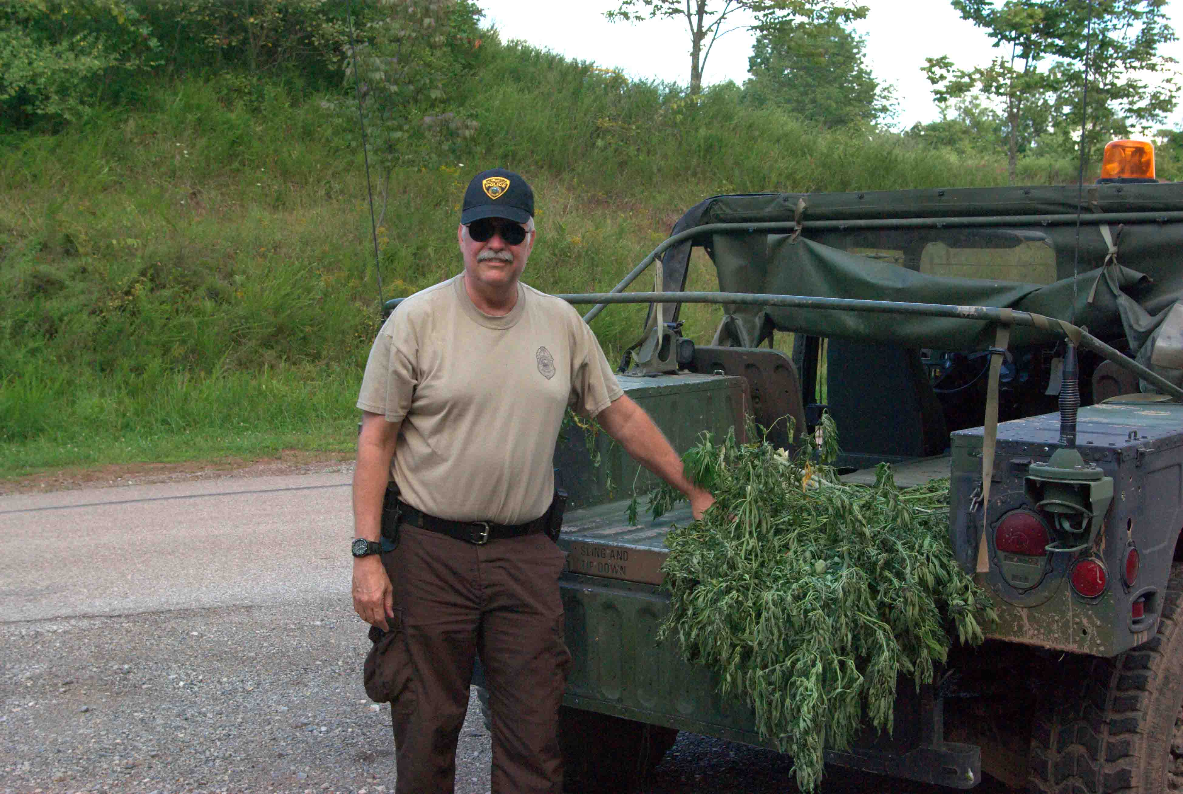 West virginia natural resources police officer steven minardi last time out hunting pot plants before retired from the dnr picture courtesy steven minardi